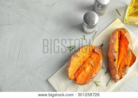 Flat Lay Composition With Baked Sweet Potatoes On Grey Background. Space For Text