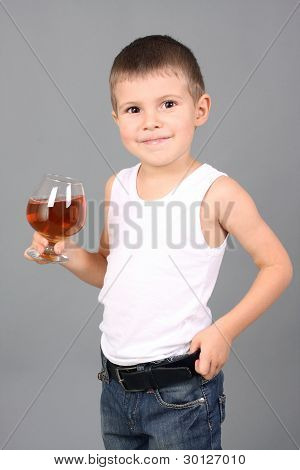 The boy holds a glass