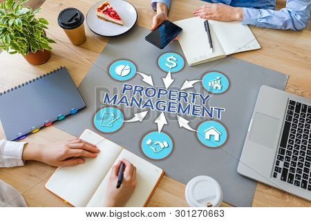 Property Management Business And Finance Concept On Office Desktop.