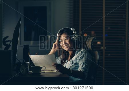 Portrait Of Asian Businesswoman Sitting And Working Hard With Happiness Action On The Table With Fro