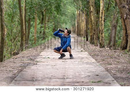 Asian Runner In Sport Suit Are Running With Happiness Action Drinking The Water From Sport Bottle Wi