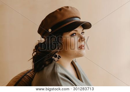 Indoor Fashion Portrait Of Plus Size Woman Wearing Trendy Animal, Leopard Print. Concept Of Autumn A