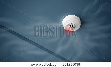 Smoke Detector And Fire Alarm System Concept - Close Up Smoke Detector On Ceiling Of Building Fire A