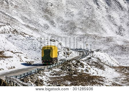 truck driving on uphill in mountain at winter
