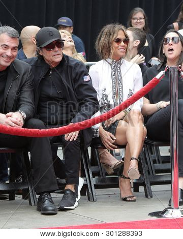 LOS ANGELES - MAY 14:  Ian McShane, Halle Berry at the Keanu Reeves Hand and Foot Print Ceremony at the TCL Chinese Theater IMAX on May 14, 2019 in Los Angeles, CA