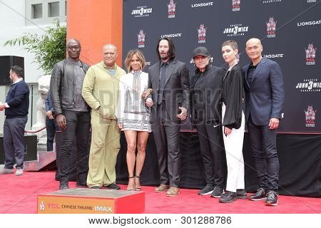 LOS ANGELES - MAY 14: Reddick, Fishburne, Berry, K Reeves, Stahelski, McShane, Dillon, Dacascos at the Keanu Reeves Hand and FootPrint Ceremony at the Chinese Theater on May 14, 2019 in Los Angeles,CA