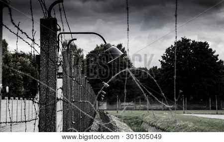 Concentration Camp Fence Silhouettes. Barbed Wire Net And Electric Fencing. Genocide, Holocaust, Wor