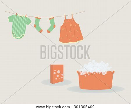Washing: Washed Baby Clothes Cute Capri Pants,socks And  Bodysuit Hanging On Clothesline And They Ar