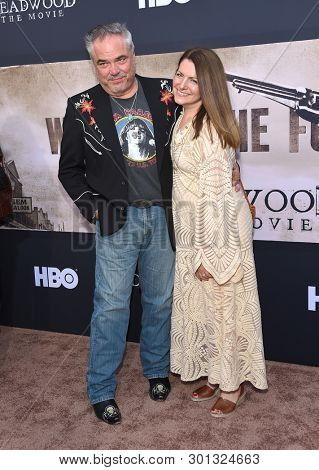 LOS ANGELES - MAY 14:  W. Earl Brown and Carrie Paschall arrives for the HBO's 'Deadwood' Premiere on May 14, 2019 in Hollywood, CA