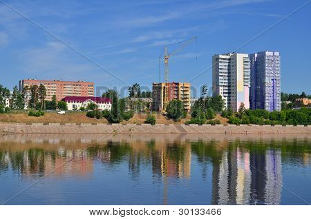 Block Of Flats And Buildings On River Bank