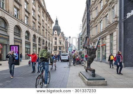 Leipzig, Germany - October 2018: Pedestrians On Street Alongside With Old Buildings In Central Busin