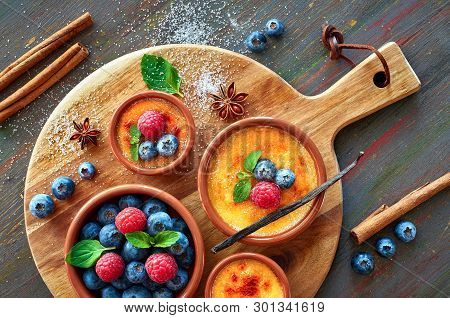 Creme Brulee (cream Brulee, Burnt Cream) Bowls Decorated With With Raspberry, Blueberry And Mint On