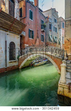 Bridge over canal Rio Della Maddalena in Venice. Italy poster