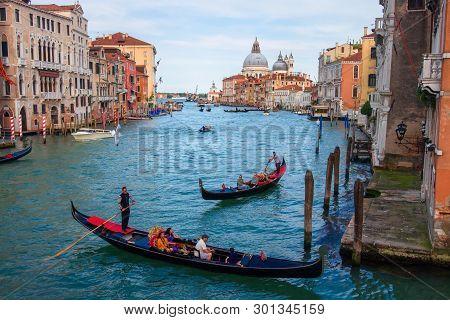 Venice, Italy - May 2, 2019: Venice, Italy - May 2, 2019: Grand Canal And Basilica Santa Maria Della