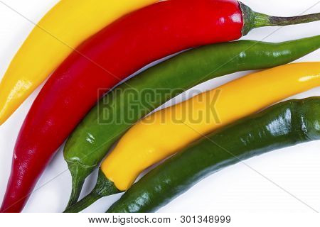 Red, Yellow And Green Hot Pepper.