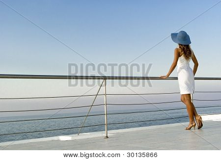 Elegant Woman Standing Near Railings And Looking On Sunset