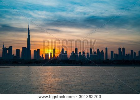 Sunrise In Dubai, Dawn Over Skyscrapers In Big City. Morning In Dubai, Sun Over Buildings. Solar Pat