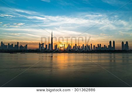 Morning Or Sunrise, Dawn In Dubai. Beautiful Colored Cloudy Sky Over Downtown Dubai. Solar Path On S