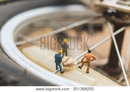 Miniature People : Mechanics Repairing Bicycle  , Concept Of The Workshop