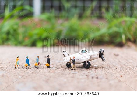 Miniature People : Travellers Hloding Carry-on Luggage Get On The Plane  , Exploring The World Conce