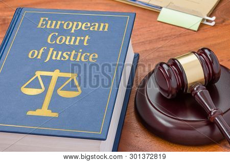 A Law Book With A Gavel - Ecj