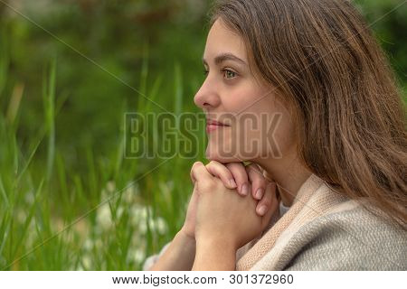 Christian Worship And Praise. A Young Woman Is Praying In The Morning.