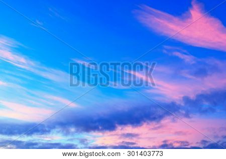 Sunset colorful sky background with pink, purple and blue dramatic colorful clouds. Vast sunset sky landscape, dramatic sunset sky landscape scene