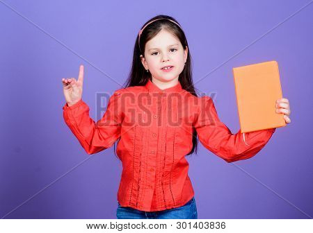 A Genius Idea. Adorable Little Child Holding Idea Book And Keeping Finger Raised. Cute Small Girl Ge