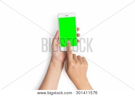 Woman Hand Use Finger Touch On Mobile Phone Button With Blank Green Screen From Top View, Isolated O