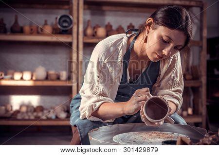 Stylish Ceramist Master  Molding A Vase Of Clay On A Potters Wheel. Pottery Workshop.