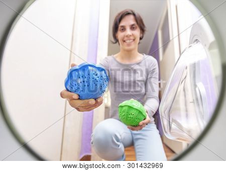 Laundry Eco Washing Thermoplastic Spheres. Woman Using Them