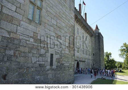 Guimaraes, Portugal - August 9, 2015:  People In A Queue To Get Into  The Palace Of The Dukes Of Bra