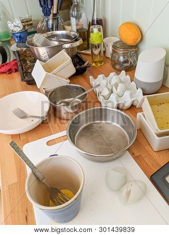 Wrexham, Uk - June 26, 2018: Authentic Messy Domestic Kitchen Worktop With Dirty Dishes, Broken Eggs