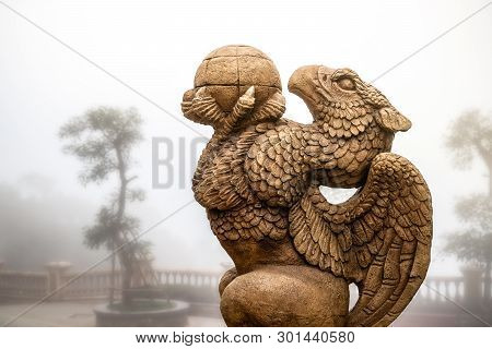 statue of Griffin or griffon a legendary creature with the body of a lion, the head and wings of an eagle poster