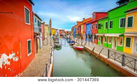 Colorful Fishermans Homes Dot Either Side Of A Canal  In The Village Of Burano In Venice, Italy
