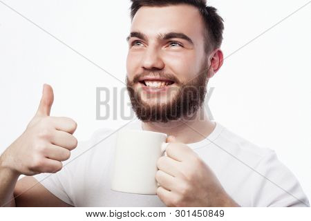 Good morning, man holding a cup tea. Morning concept. Handsome bearded male holds cup of coffee, tea. Smiling hipster man with cup of fresh coffee.  Isolated over white background.
