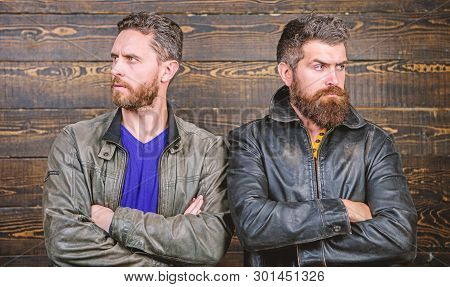 Men brutal bearded hipster. Exude masculinity. Confident competitors strict glance. Masculinity concept. Masculinity attributes. True man temper. Brutality confidence and masculinity interconnection poster