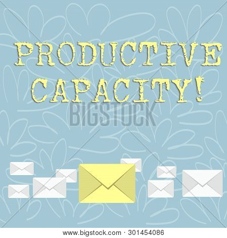 Writing note showing Productive Capacity. Business photo showcasing the maximum possible output of a production plant Color Envelopes in Different Sizes with Big one in Middle. poster