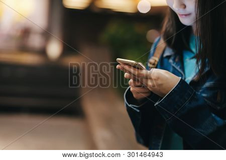 Teen Girl Using Mobile Phone To Chat And Send Message.