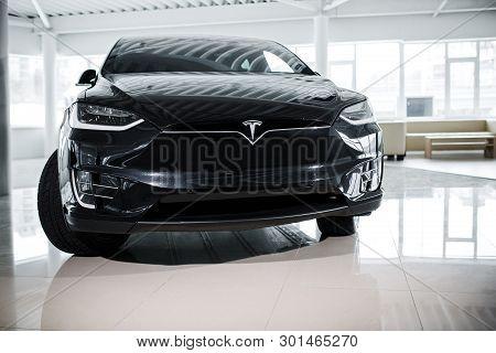 Powerful Enviroment-friendly Tesla Automobile In Auto Show. Premium Segment Electric Vehicle Standin
