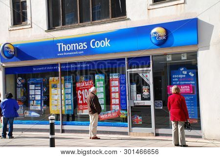 HASTINGS, ENGLAND - MARCH 9, 2009: Exterior of a branch of Thomas Cook travel agents. Founded in 1841, the business announced a £1.46 billion half year loss in May 2019.