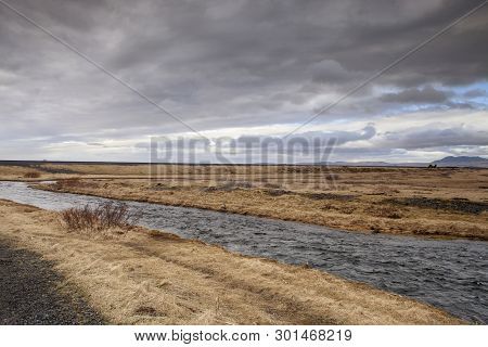 The Seljalands River In Iceland Flows From The Stratovolcano