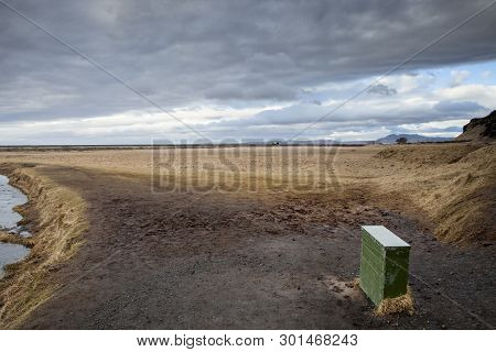 The Stark Winter Landscape In Iceland With Dark Clouds Overhead
