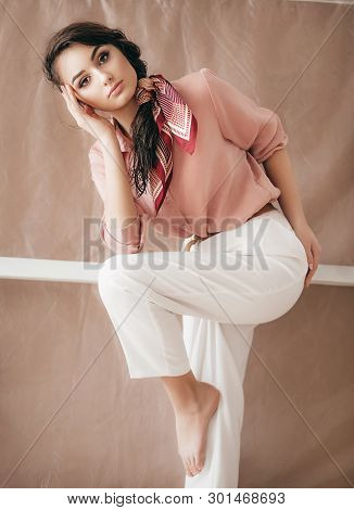 Portrait of beautiful young girl with makeup. Stock photo.