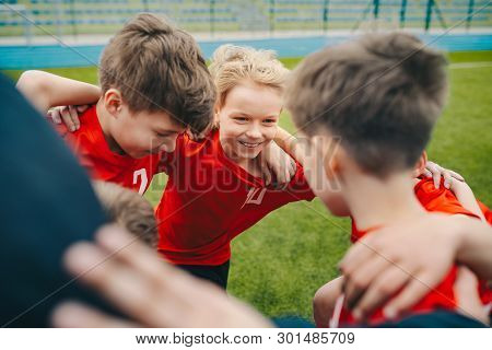 Happy Children Making Sport. Group Of Happy Boys Making Sports Huddle. Smiling Kids Standing Togethe