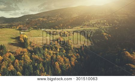Multicolored Sunset Autumn Highland Scenery Aerial View. Epic Carpathian Mountain Meadow Cottage Village Path Overview. Deep Wood Eco Friendly Wildlife Natural Environment Drone Flight