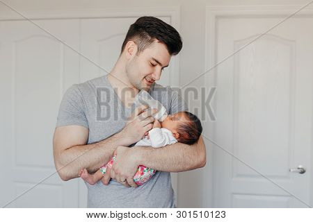 Portrait Of Young Caucasian Father Dad Feeding Asian Chinese Mixed Race Newborn Baby Son Daughter Wi