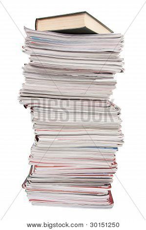 Stack Of Old Magazines And A Book