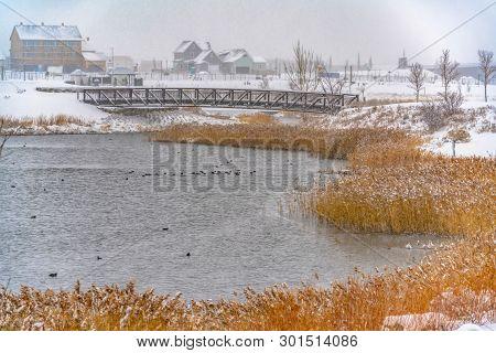 Lakefront Homes In Daybreak Viewed In Winter