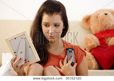 Heart-broken teenage girl looking sad at home.?